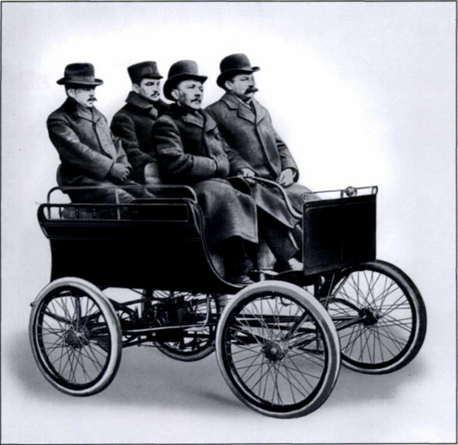 Ignaz Schwinn (left) and Adolph Arnold (right) in Schwinn's prototype horseless carriage. From the book Schwinn Bicycles