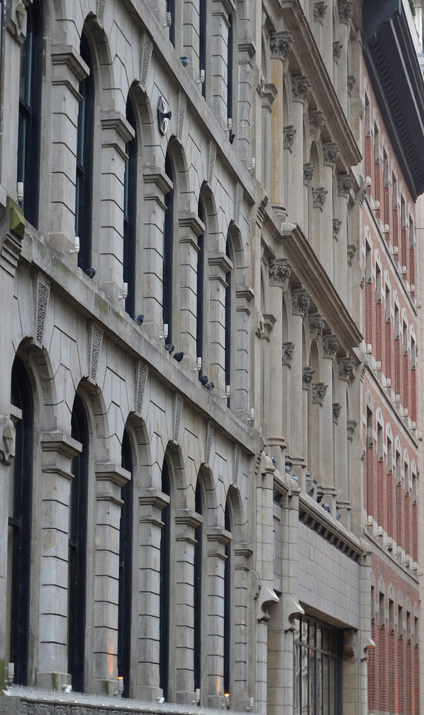 Detail of facades of 129 - 137 North Wabash Avenue.