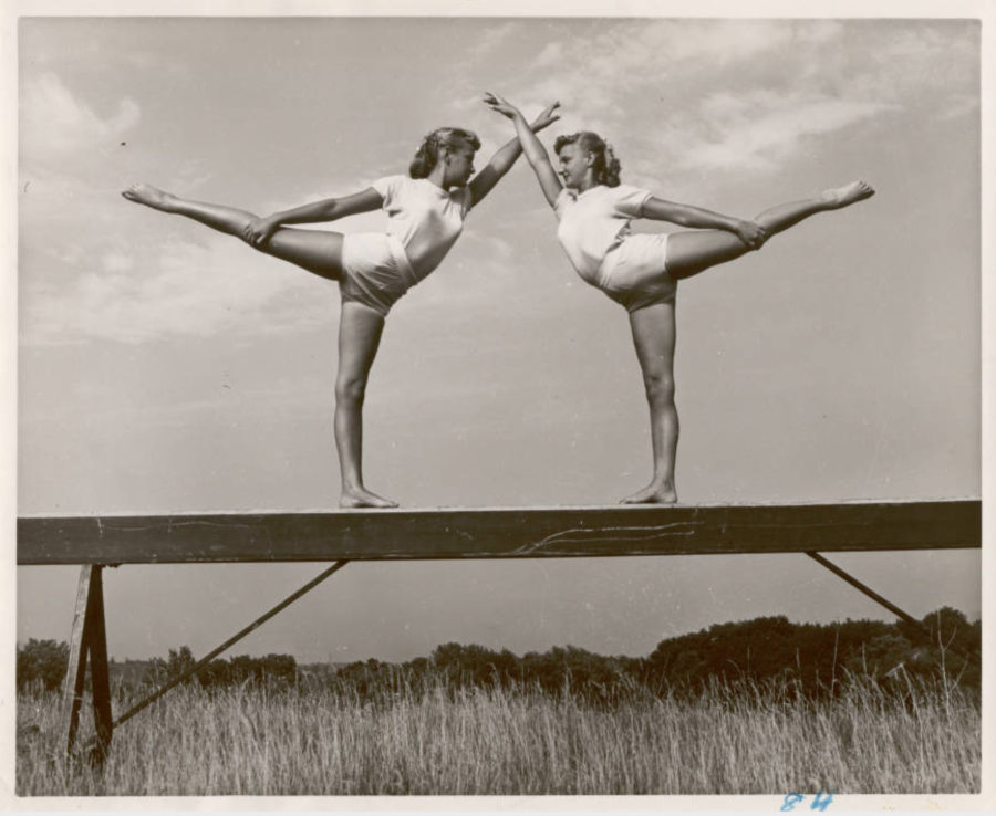 Mary Ann Aenbert and Alyce Vogel on the balance beam at Illinois Turner Camp, 1954 [ American Turners Collection, IUPUI University Library Special Collections and Archives]